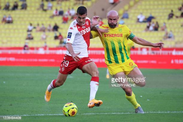 Monaco's Italian forward Pietro Pellegri vies for the ball with Nantes' French defender Nicolas Pallois during the French L1 football match between...