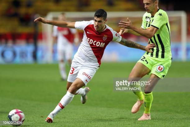 Monaco's Italian forward Pietro Pellegri vies with Angers' French defender Romain Thomas during the French L1 football match Monaco vs Angers on...