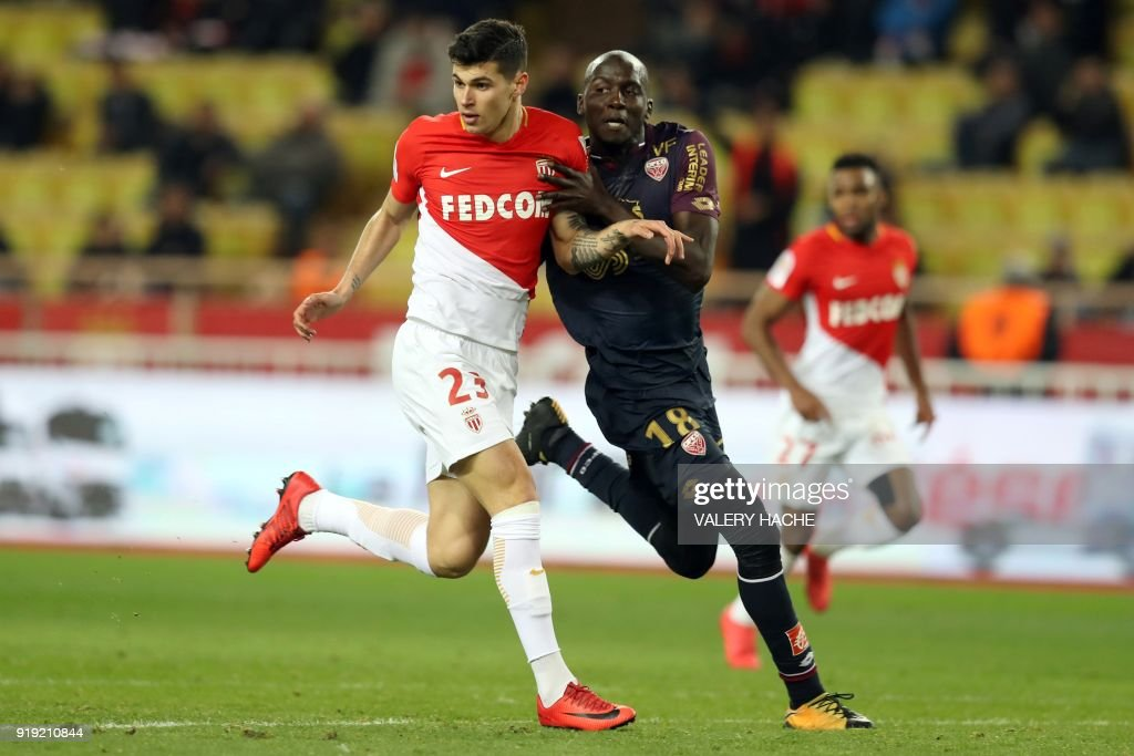 Monaco's Italian forward Pietro Pellegri (L) vies with Dijon's French defender Cedric Yambere (R) during the French L1 football match Monaco vs Dijon on February 16, 2018 at the Louis II Stadium in Monaco. /