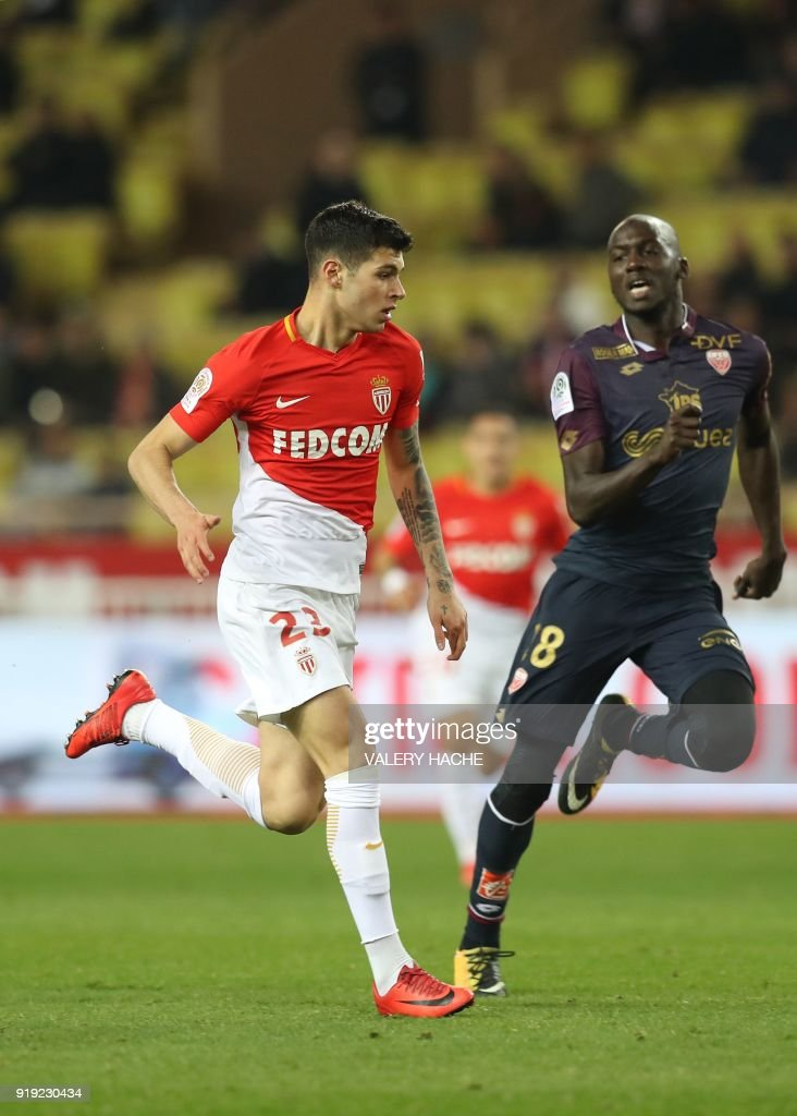 Monaco's Italian forward Pietro Pellegri (L) vies with Dijon's French defender Cedric Yambere (R) during the French L1 football match Monaco vs Dijon on February 16, 2018 at the Louis II Stadium in Monaco. Defending champions Monaco eased to a 4-0 home win over Dijon in French Ligue 1 on February 16 as 16-year-old Pietro Pellegri carved out a little piece of history for himself. Meanwhile, Pellegri, at 16 years, 10 months and 30 days, became the youngest player to appear for Monaco when he came on as an 88th minute substitute. /