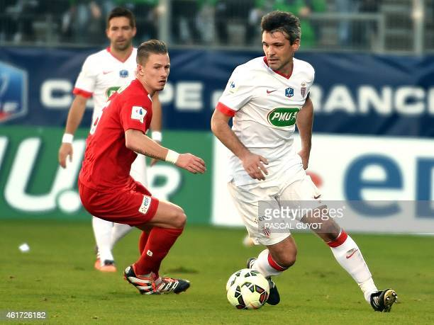 Monaco's Jeremy Toulalan vies with Nimes' Jonathan Parpeix during the FrenchCup football match Nimes vs Monaco on January 4 2015 at the Costieres...