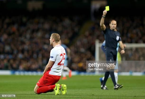 Monaco's Kamil Glik is booked my referee Antonio Miguel Mateu Lahoz