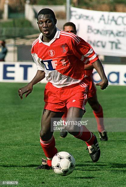 Monaco's Liberian forward George Weah runs with the ball during the French Cup quarterfinal soccer match between Ajaccio and Monaco 22 April 1992 in...