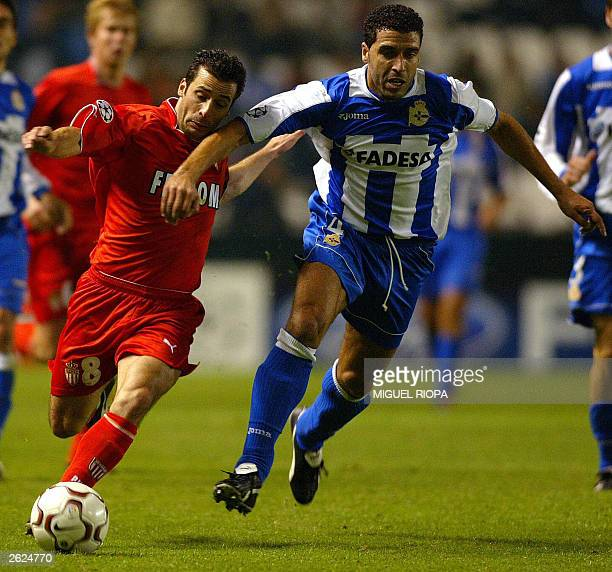Monaco's Ludovic Giuly fights for the ball with Deportivo Coruna's Moroccan Nourredine Naybet during the Champions League match at Riazor stadium in...