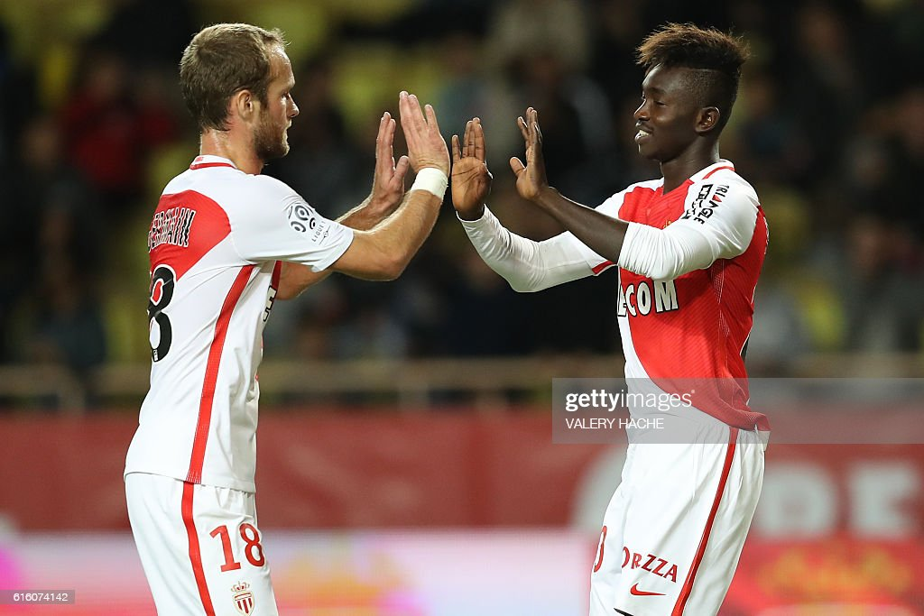 Monaco's midfielder Adama Traore (R) celebrates with Monaco's French forward Valere Germain after scoring a goal during the French L1 football match between AS Monaco and Montpellier at the Louis II Stadium in Monaco on October 21, 2016. / AFP / VALERY