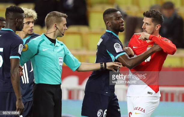 Monaco's Montenegrin forward Stevan Jovetic speaks to French referee Clement Turpin during the French L1 football match Monaco vs Lille on March 16...