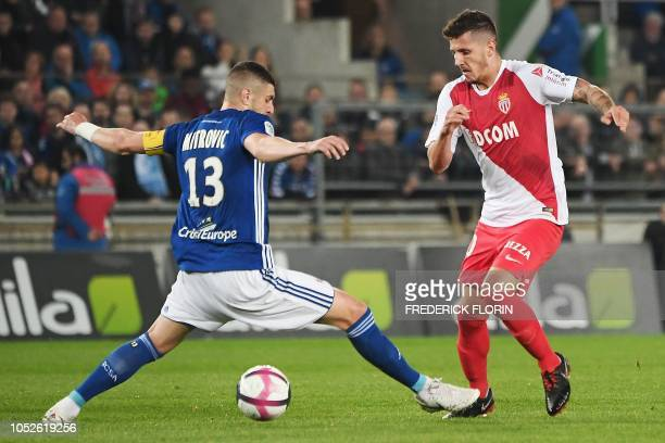 Monaco's Montenegrin forward Stevan Jovetic vies for the ball against Strasbourg's Serbian defender Stefan Mitrovic during the French L1 football...