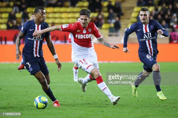 Monaco's Montenegrin forward Stevan Jovetic vies for the ball with Paris SaintGermain's French defender Presnel Kimpembe and Paris SaintGermain's...