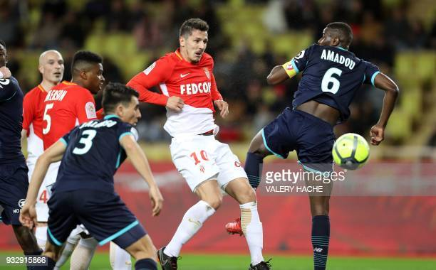 Monaco's Montenegrin forward Stevan Jovetic vies with Lille's French midefielder Ibrahim Amadou during the French L1 football match between Monaco...