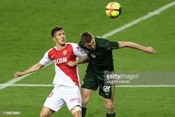 Monaco's Montenegrin forward Stevan Jovetic vies with Reims' Belgian defender Björn Engels during the French L1 football match between AS Monaco and...