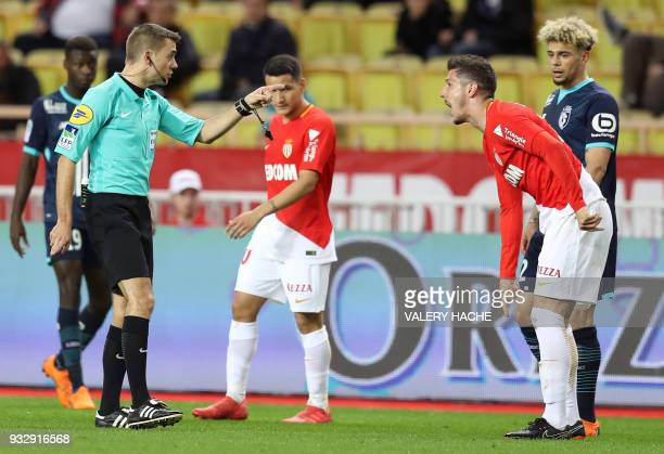 Monaco's Montenergin forward Stevan Jovetic speaks to the French referee Clement Turpin during the French L1 football match Monaco vs Lille on March...