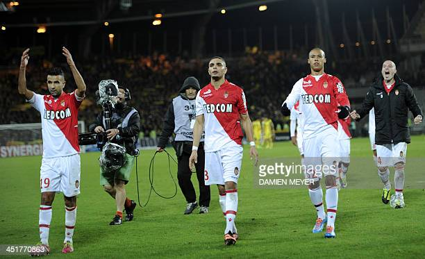 Monaco's Moroccan midfielder Mounir Obbadi cheers supporters with teammates after winning the French L1 football match Nantes against Monaco on...