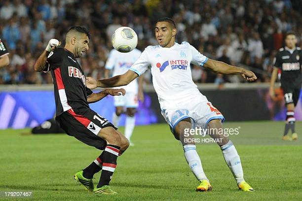Monaco's Moroccan midfielder Mounir Obbadi vies for the ball with Marseille's French forward Dimitri Payet during the French L1 football match...