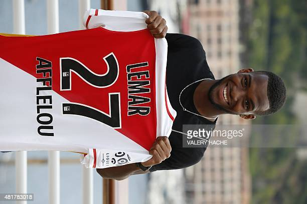 AS Monaco's new French midfielder Thomas Lemar poses with his new jersey during a press conference in Monaco on July 24 2015 AFP PHOTO / VALERY HACHE