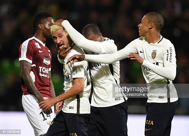 Monaco's players celebrate after scoring a goal during the French L1 football match between Metz and Monaco on October 1, 2016 at Saint Symphorien...
