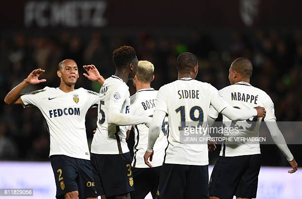 Monaco's players celebrate after scoring a goal during the French L1 football match between Metz and Monaco on October 1 2016 at Saint Symphorien...