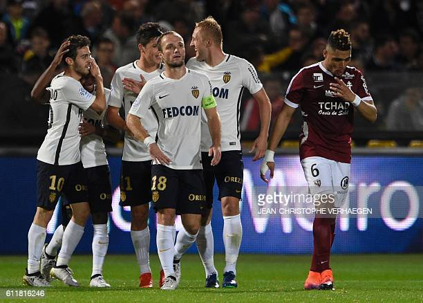 Monaco's players celebrate after scoring during the French L1 football match between Metz and Monaco at the Saint Symphorien stadium in...