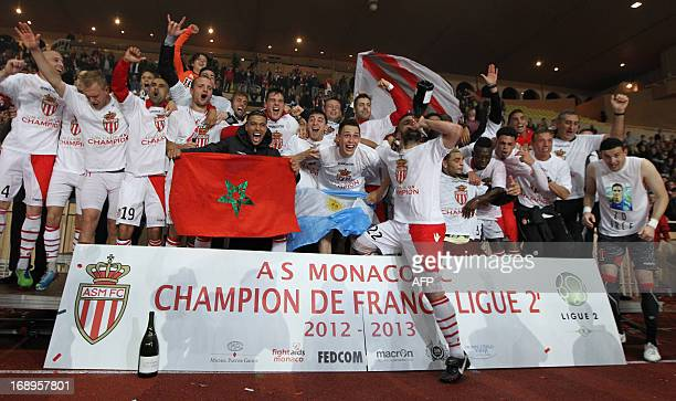 Monaco's players celebrate after winning the L2 championship at the end of the French L2 football match Monaco vs Le Mans on May 17 at the Louis II...