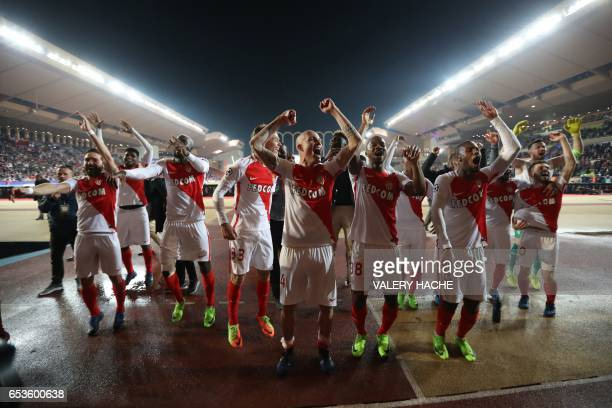 Monaco's players celebrate at the end of the UEFA Champions League round of 16 football match between Monaco and Manchester City at the Stade Louis...