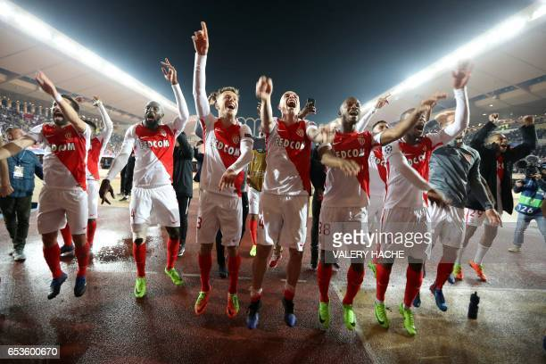 TOPSHOT Monaco's players celebrate at the end of the UEFA Champions League round of 16 football match between Monaco and Manchester City at the Stade...