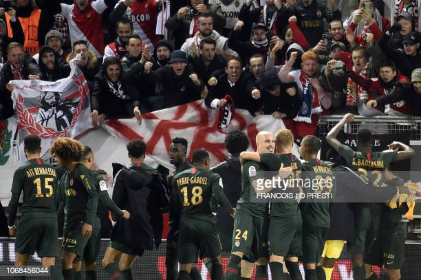 Monaco's players celebrate their victory at the end of the French L1 football match between Amiens SC and AS Monaco at the Licorne stadium in Amiens...