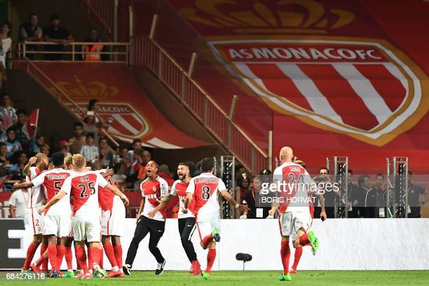 Monaco's players celebrate winning the French championship after winning the French L1 football match Monaco vs St Etienne on May 17 at the Louis II...