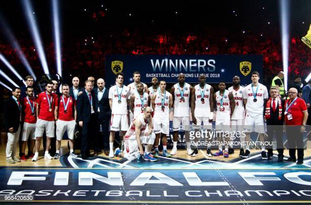 AS Monaco's players pose for a family picture and celebrate their second place at the end of the Final Four Champions League basketball final game...