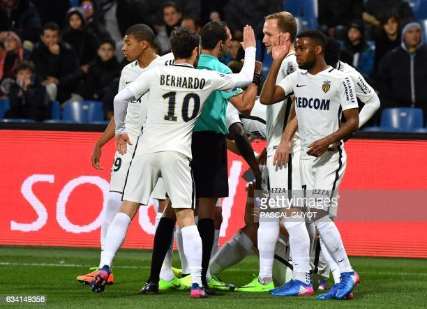 Monaco's players react after scoring a goal during the French L1 football match between MHSC Montpellier and Monaco on February 7 2017 at the La...