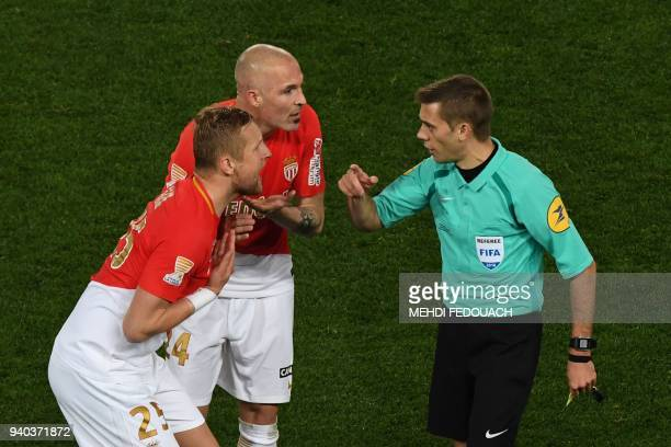 Monaco's Polish defender Kamil Glik and Monaco's Italian defender Andrea Raggi speak with French referee Clément Turpin during the French League Cup...