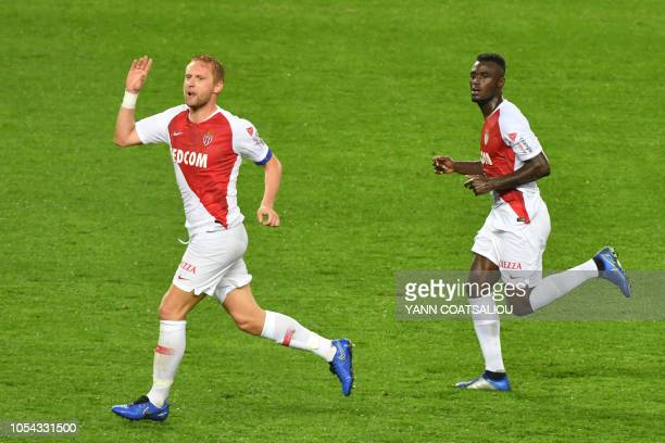Monaco's Polish defender Kamil Glik celebrates after scoring a goal during the French L1 football match AS Monaco FC vs Dijon FCO at the Louis II...