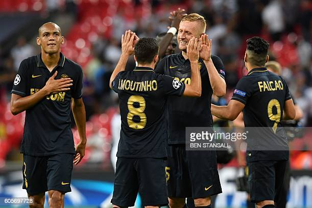 Monaco's Polish defender Kamil Glik celebrates with Monaco's Portuguese midfielder Joao Moutinho after winning the UEFA Champions League group E...
