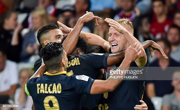 Monaco's Polish defender Kamil Glik celebrates with team mates after scoring a goal during the French L1 football match between Lille OSC and AS...