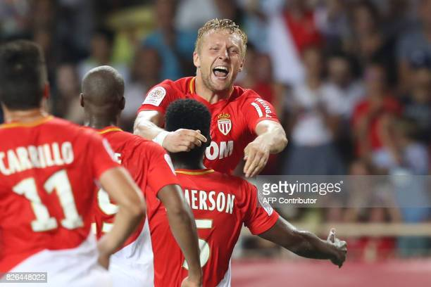 Monaco's Polish defender Kamil Glik celebrates with teammates after scoring a goal during the French L1 football match between Monaco and Toulouse at...