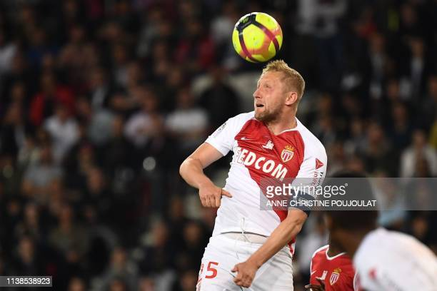 Monaco's Polish defender Kamil Glik heads the ball during the French L1 football match between Paris Saint-Germain and Monaco on April 21, 2019 at...