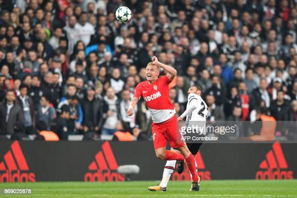 Monaco's Polish defender Kamil Glik vies with Besiktas' Turkish forward Cenk Tosun during the UEFA Champions League Group G football match between...