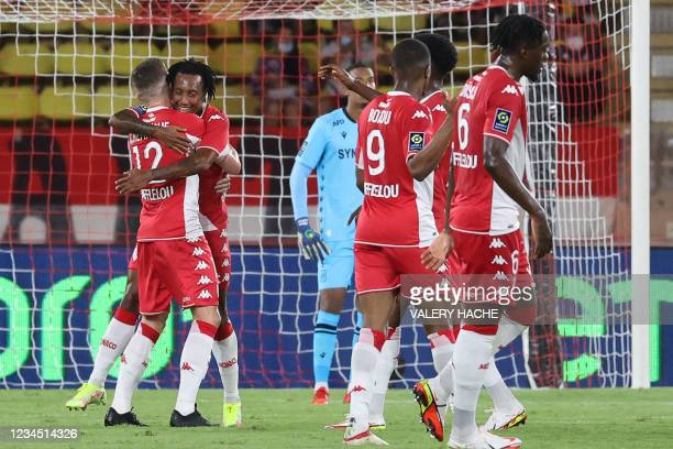 Monaco's Portugese midfielder Gelson Martins celebrates with teammates after scoring his team's first goal during the French L1 football match...
