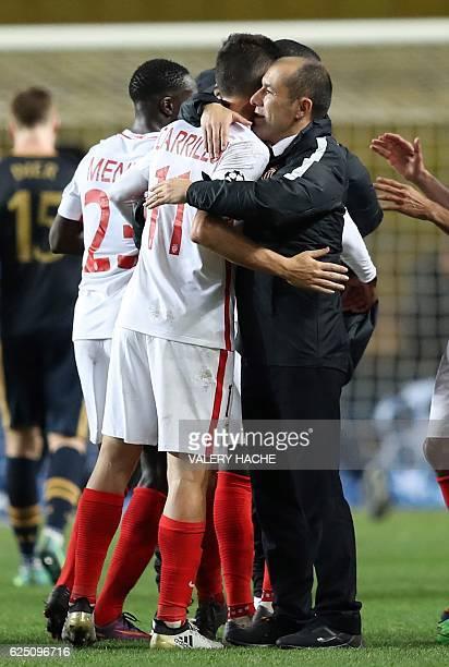 Monaco's Portuguese coach Leonardo Jardim celebrates with Monaco's Argentinian forward Guido Carrillo after winning the UEFA Champions League group E...