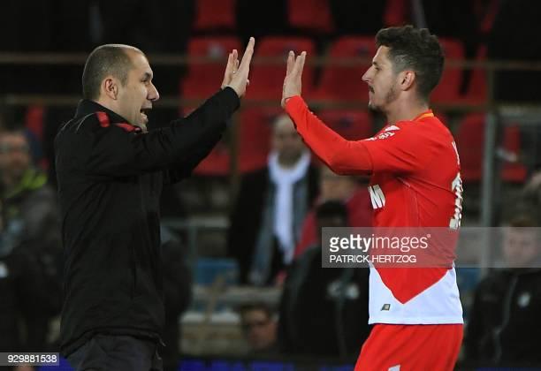 Monaco's Portuguese coach Leonardo Jardim congratulates Monaco's Yugoslavian forward Stevan Jovetic during the French Ligue 1 football match between...