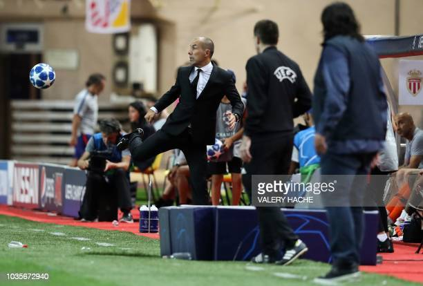 Monaco's Portuguese coach Leonardo Jardim controls the ball during the UEFA Champions League first round football match between AS Monaco and...