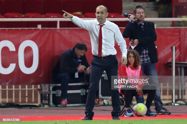 Monaco's Portuguese coach Leonardo Jardim gives his instructions as French player Hannibal Mejbri looks on during the French L1 football match Monaco...