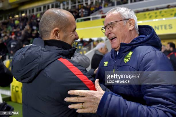 Monaco's Portuguese coach Leonardo Jardim jokes with Nantes' Italian head coach Claudio Ranieri before the French L1 football match Nantes vs Monaco...