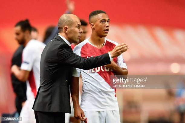 Monaco's Portuguese coach Leonardo Jardim speaks with Monaco's Belgian midfielder Youri Tielemans during the UEFA Champions League first round...