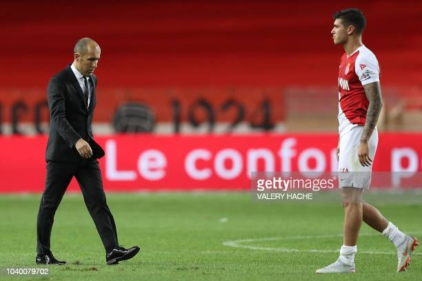 Monaco's Portuguese coach Leonardo Jardim walks on the pitch after being defeated by Angers at the end of the French L1 football match Monaco vs...