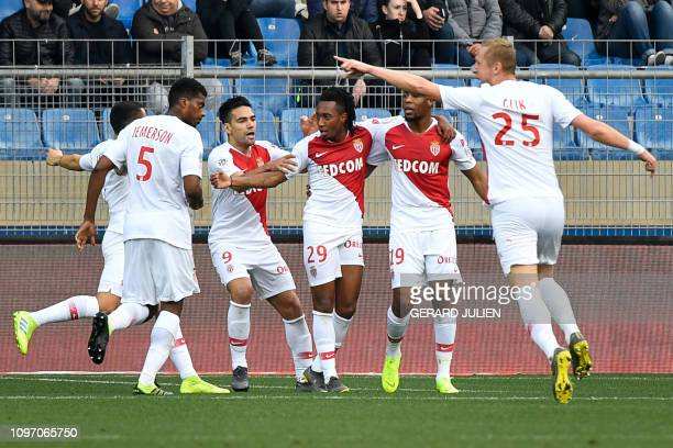 Monaco's Portuguese forward Gelson Martins celebrates with his teammates after scoring during the French L1 football match between Montpellier...