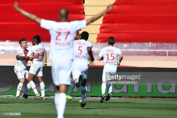 Monaco's Portuguese forward Gelson Martins celebrates with teammates after scoring a goal during the French L1 football match between AS Monaco and...