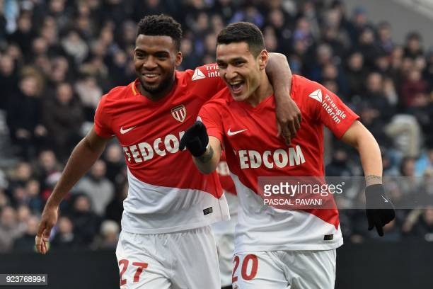 Monaco's Portuguese forward Rony Lopes celebrates with his teammate Monaco's French midfielder Thomas Lemar after scoring a goal during the French L1...
