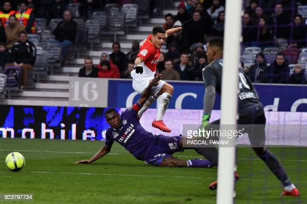 Monaco's Portuguese forward Rony Lopes vies with Toulouse's French defender Issa Diop and Toulouse's French goalkeeper Alban Lafont during the French...