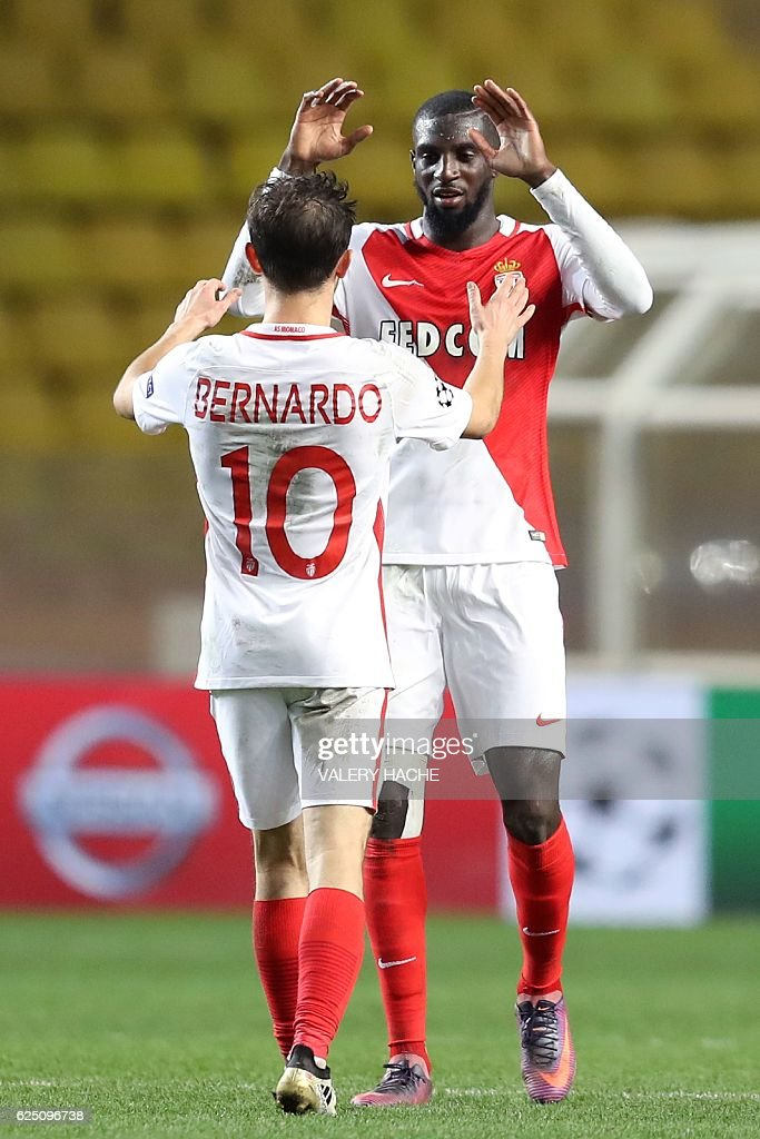Monaco's Portuguese midfielder Bernardo Silva (L) celebrates with Monaco's French midfielder Tiemoue Bakayoko after winning the UEFA Champions League group E football match AS Monaco and Tottenham Hotspur FC at the Louis II stadium in Monaco on November 22, 2016. / AFP / Valery HACHE