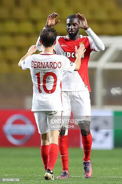 Monaco's Portuguese midfielder Bernardo Silva celebrates with Monaco's French midfielder Tiemoue Bakayoko after winning the UEFA Champions League...