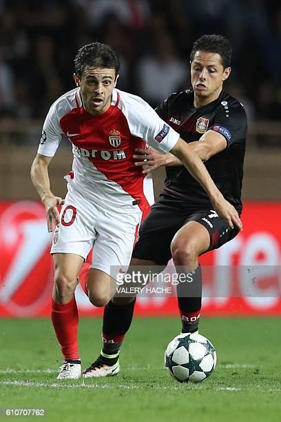 Monaco's Portuguese midfielder Bernardo Silva vies with Leverkusen's Mexican forward Javier Hernández Balcázar during the UEFA Champions League...